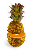 The transformation of pineapple in orange. On a white background royalty free stock photo