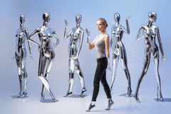 Transformation of woman in dummy in background many metal mannequins Stock Photos