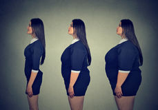 Transformation. Young fat woman becoming slim fit girl. Diet choice right nutrition healthy lifestyle concept royalty free stock photography