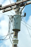 Transformer. On wooden pole with wiring and insolators royalty free stock images