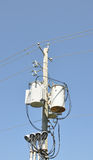Transformer. Electrical transformer against a bright blue sky Stock Images