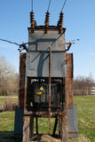 Transformer. Old rusty high voltage transformer in the countryside royalty free stock photos