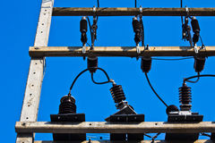 Transformer. Electrical transformer pole aganist blue sky Stock Photo