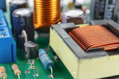 Transformer and electronic components installed on a printed circuit board closeup Stock Images
