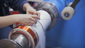 Transformer, engine production. Worker winding cooper wires on a high voltage transformer. Slider shoot. HD stock video
