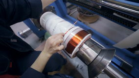 Transformer, engine production. Worker winding cooper wires on a high voltage transformer. Slider shoot. HD stock footage