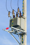 Transformer on high power station in the sun. Royalty Free Stock Photos
