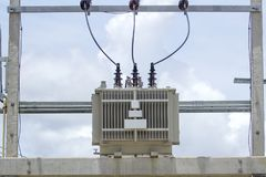 The transformer is located on a cementitone pole.  Stock Image