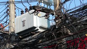 Transformer and multitude of electrical wires. On electric post stock footage