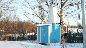 Transformer substation on a winter day. On the edge of the village stock footage