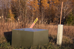 Transformer and telco pedestal. In fall scennery Stock Photo
