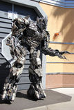 Transformers at Universal Studios Hollywood. Los Angeles, California, USA - March 12, 2015: The Impersonator of Transformers movie is welcoming tourists in front Royalty Free Stock Photos
