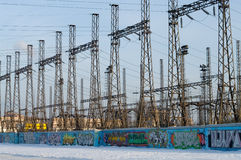Transforming station with lines transmission. Transforming station with high voltage lines transmission on the blue sky background. It`s a winter Royalty Free Stock Photo