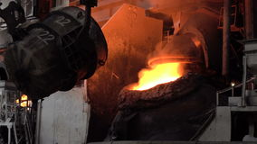 Transfusion of iron from the ladle into a basic oxygen furnace to purge. Stages of the steel plant for the production of steel and iron stock video footage