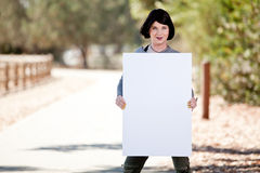 Transgender with blank poster board sign. Transgendered person holding poster board for editing activist phrases or hashtags Royalty Free Stock Image