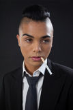 Transgender with cigarette in mouth Royalty Free Stock Images
