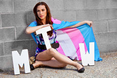 Transgender female with pride flag. Transgender female holding pride flag hiding half her face Stock Photos