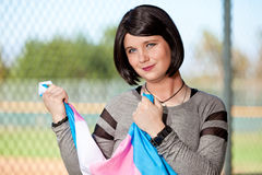 Transgender gripping pride flag in hands. Transgendered person holding pride flag in her hands Royalty Free Stock Photos