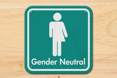 Transgender sign with text Gender Neutral. Transgender sign, Teal and white sign with a transgender symbol with text Gender Neutral on wood Royalty Free Stock Photo