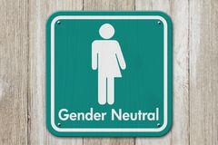 Transgender sign with text Gender Neutral. Transgender sign, Teal and white sign with a transgender symbol with text Gender Neutral on weathered wood stock photos