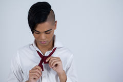 Transgender woman tying necktie Royalty Free Stock Images