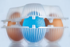 Transgenic food. Eggs package, the blue egg stands for GMO food Stock Photo