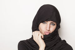 Transgressive girl wearing a burqa Royalty Free Stock Image