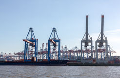 Transhipment cranes in Hamburg Sea Port. The Port of Hamburg is a sea port on the river Elbe in Hamburg, Germany. It is Germany`s largest port and second Stock Image