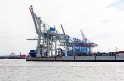 Transhipment cranes in Hamburg Sea Port. The Port of Hamburg is a sea port on the river Elbe in Hamburg, Germany. It is Germany`s largest port and second Stock Photo