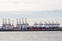 Transhipment cranes in Hamburg Sea Port. The Port of Hamburg is a sea port on the river Elbe in Hamburg, Germany. It is Germany`s largest port and second Royalty Free Stock Photography