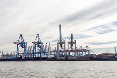 Transhipment cranes in Hamburg Sea Port. The Port of Hamburg is a sea port on the river Elbe in Hamburg, Germany. It is Germany`s largest port and second Stock Photography