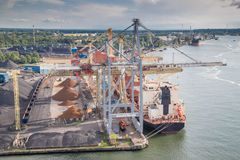 Transhipment port. Unloading of the ship in the harbor Royalty Free Stock Photo