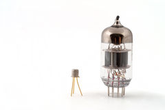 Transistor next to a vacuum tube royalty free stock image