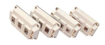 Transistores potentes de IGBT aislados en el fondo blanco fotografía de archivo libre de regalías