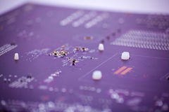 Transistors. A bunch of transistors on a mainboard Stock Images
