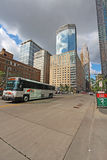 Transit bus and partial skyline of Minneapolis, Minnesota vertic Royalty Free Stock Photography