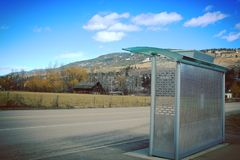 Transit Bus Shelter And Rural Landscape Royalty Free Stock Image