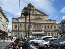 Transit in front of the Colon Theater of Buenos Aires on a summer morning Argentina. NnThe Teatro Colón is an opera house in the city of Buenos Aires. Due to Royalty Free Stock Images