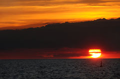 Transit sunset. Transit of Venus across the sun, as it sets over Lake Erie Royalty Free Stock Image