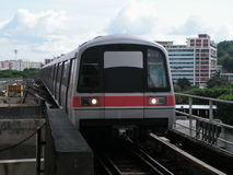 Transit train approach station. Taken  in singapore, a very reliable form of transport Stock Photography