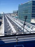 Transit train between ternimals. View of transit train way between terminals in Toronto Pearson International Airport on sunny day in spring. Toronto, Ontario Royalty Free Stock Image