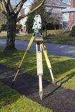 Transit and Tripod. An instrument used for measuring and calculating angles for land and construction Stock Photo