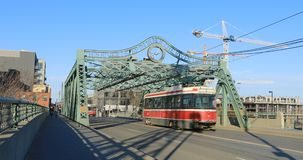 Transit vehicle on the Queen Street Bridge in Toronto 4K. A Transit vehicle on the Queen Street Bridge in Toronto 4K stock video footage