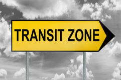Transit zone traffic sign with black and white cloudy sky Stock Photography