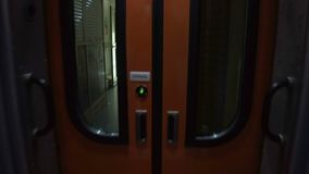 Transition from one train car to another. Opening of automatic intercity doors stock video footage