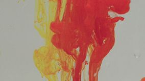 Transition red and yellow color ink Dropped Into Water. Abstract transition red and yellow color ink Dropped Into Water stock footage