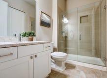 Transitional bathroom interior design in soft beige colors Stock Image