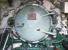 Transitive the hatch. Of an old submarine Royalty Free Stock Image