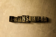 TRANSLATED - close-up of grungy vintage typeset word on metal backdrop. Royalty free stock illustration.  Can be used for online banner ads and direct mail Royalty Free Stock Photography