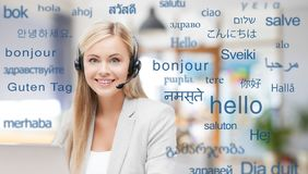 Woman in headset over words in foreign languages royalty free stock image
